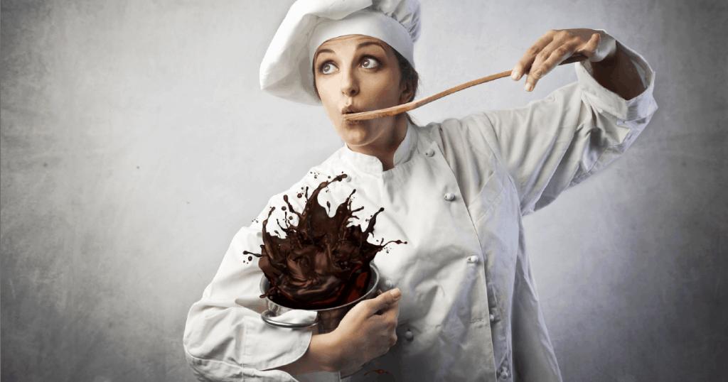 chef tasting cake mix