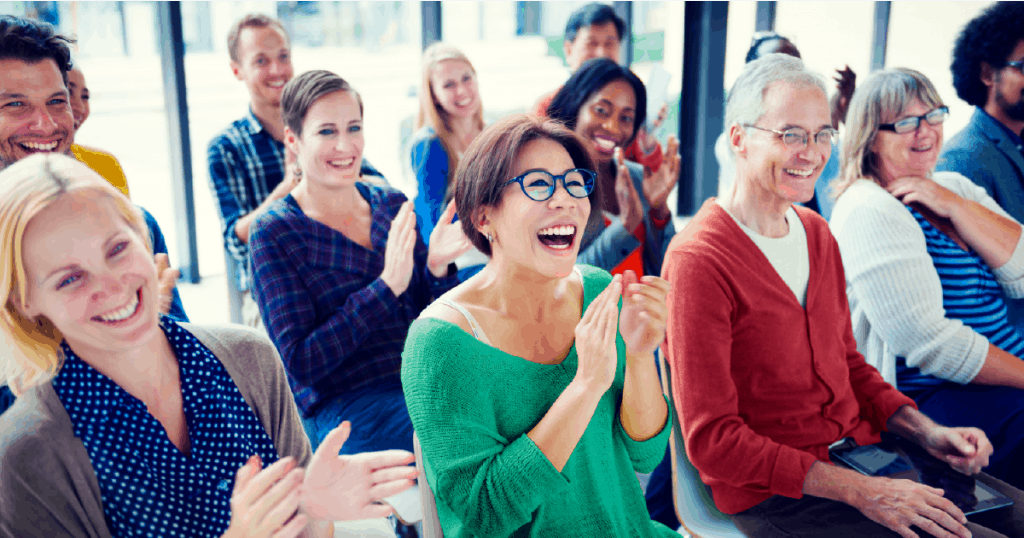 potential clients applauding after a sales presentation
