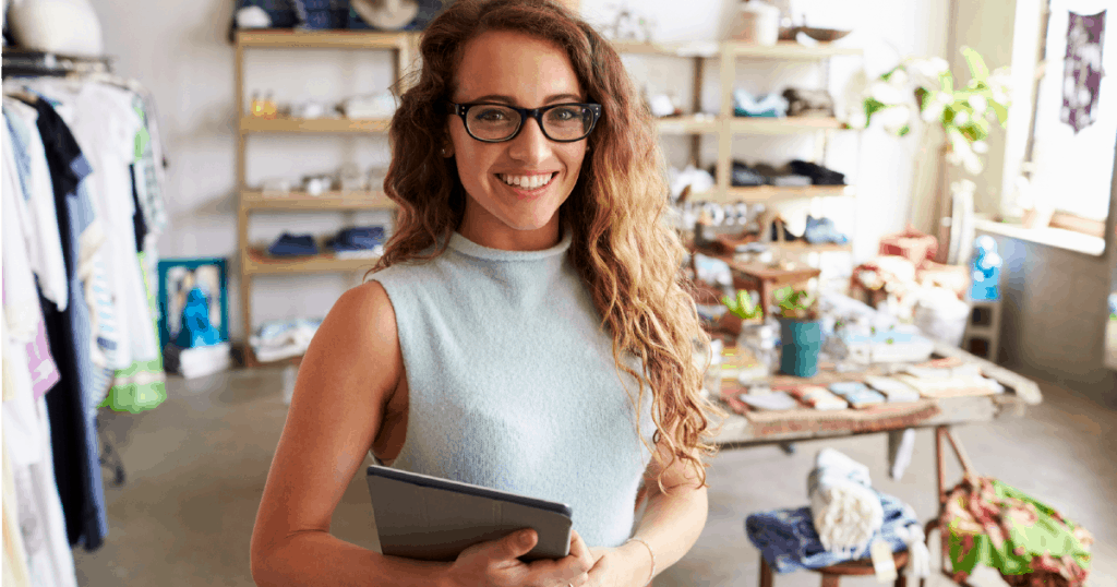 Business owner price setting in her clothing shop