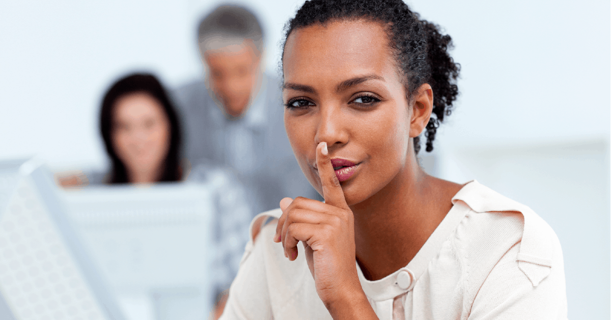 woman in business signaling don't say this