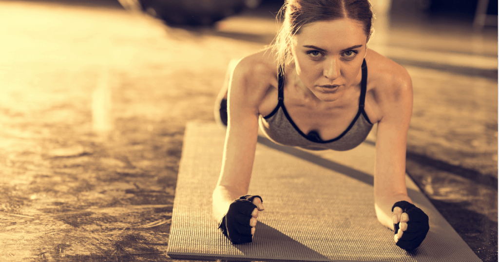 Athletic woman doing planks