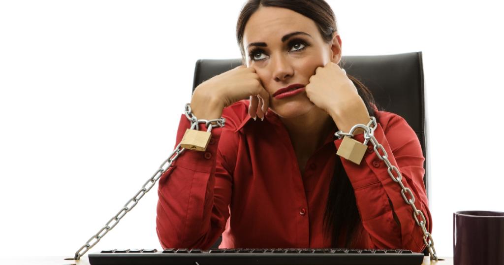Business woman stuck at desk